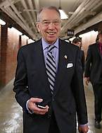 Senator Chuck Grassley (R-IA) talks with his staff as he walks in the basement of the US Capitol Building in Washington, DC on Wednesday, April 10, 2013.