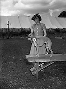 """04/08/1952 <br /> 08/04/1952<br /> 04 August 1952  <br /> Dog Show, 18th Annual Green Star Championship at Monkstown, Co. Dublin. Miss C.A. Dorrity, 4 Seaview Terrace, Ailesbury Road, Dublin, with her Best of Breed Whippet """"Fleeting Flagman""""."""