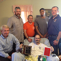 CHING RECEIVES PLAQUES<br /> (Courtesy Photo)<br /> David Ching was presented the Roy Gray Memorial Firefighter of the Year Award and his 5-year Service plaque last week. Shown making a special trip to bestow the award on Ching was Bobby Sanderson, Jason Davis, Curt Jernigan, Jeffery Jones and Jonathan Blankenship.