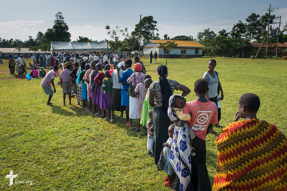 Residents from surrounding villages line up to register for the Mercy Medical Team clinic Thursday, June 12, 2014, at the Luanda Doho Primary School in Kakmega County, Kenya. LCMS Communications/Erik M. Lunsford