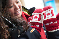 Visitors and residents wear red and white to support Canadian athletes as part of the 2010 Winter Olympic Games in Whistler, BC Canada.