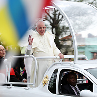 (091915  Havana, Cuba) Pope Francis waves to a crowd as he arrives in the Miramar neighborhood of Havana, Saturday, September 19, 2015. Cuban Cardinal Jaime Ortega, second from left, rides on the back of the Popemobile. photo by Angela Rowlings.