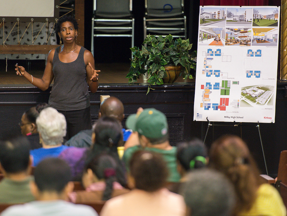 Kirksey architects and Milby principal Roy De La Garza discuss the progress on the Milby High School project during a community meeting at Deady Middle School, July 1, 2014.