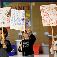 Kamden Cisse (left to right), Carl Olson, Xander Winter and other classmates silently march around the lunchroom at Harvey Dunn elementary school in honor of Martin Luther King Jr. Day on Monday, Jan. 16, 2017. The third grade students from Nicole Gardner-Fink's class marched to raise awareness of Martin Luther King Jr. for the kindergarten and first grade students.