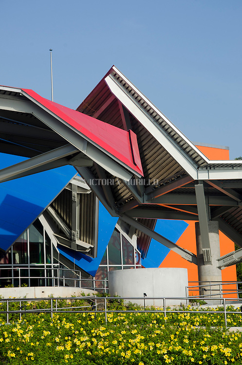 Biomuseo - Bridge life<br /> Panama City- Panama , March 2014.<br /> Front West Biomuseo<br /> Designed by architect Frank Gehry , winner of the Pritzker Prize and recognized for the innovative and unique ways of designing buildings , the Biomuseo is his first work in Latin America and the tropics. The building was designed to tell the story of how the Isthmus of Panama rose from the sea , uniting two continents , a vast ocean separating into two and changing the biodiversity of the planet forever.<br /> <br /> The museum, 4,000 m2, will have eight permanent exhibition galleries , designed by Bruce Mau sequentially Design.<br /> <br /> The permanent exhibition is titled Biomuseo Panama : Bridge of Life . Eight galleries - Eight &quot; artifacts amazement&quot; tell us the origin of the Isthmus of Panama and its huge impact on biodiversity.<br /> <br /> Besides being an architectural icon , also plans to have a profound impact on the educational work of the entire population , particularly in biodiversity issues .<br /> <br /> The Biomuseo is located in the Amador Causeway , a prominent entrance to the Panama Canal into the Pacific Ocean area . From Biomuseo can clearly observe the profile of the modern city, the Old Town , Ancon Hill and the Bridge of the Americas. This area was restricted to Panamanians during the days of the former US-controlled Canal Zone. (Photo by Victoria Murillo/LatinContent/Getty Images)