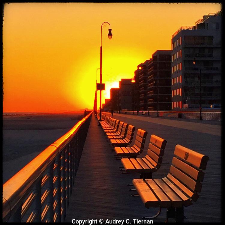 Long Beach, NY: May, 2015--- The sun sets on the Long Beach Boardwalk on Long Island, NY. © Audrey C. Tiernan