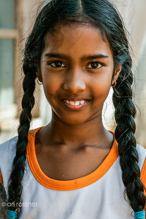 Portrait of a smiling young girl with her braided hair.