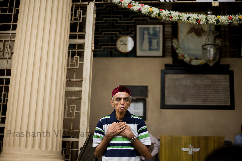 A Parsi man prays as he leaves the Kappawala Agiary, or Fire Temple, on Navroze, the Parsi new year, in Mumbai, India, Tuesday, Aug. 19, 2008. Parsis, also known as Zoroastrians, worship fire and are followers of the Bronze Age Persian prophet Zarathustra. According to estimates there are only 150,000 Zoroastrians in the world today and more than 80,000 live in India, mostly in Mumbai. Photographer:Prashanth Vishwanathan/Atlas Press