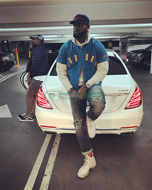 "LeBron James releases a photo on Instagram with the following caption: ""On the lookout wit my woe @teamswish for  haters that don't wanna see you shine. They come in all shapes, colors and sizes so be aware! Put on your blinders, focus and push towards inspiring, greatness and happiness! If they don't bring energy towards you, don't be around them. #livelaughlove\ud83d\ude01\ud83e\udd23\u2764\ufe0f #striveforgreatness\ud83d\ude80"". Photo Credit: Instagram *** No USA Distribution *** For Editorial Use Only *** Not to be Published in Books or Photo Books ***  Please note: Fees charged by the agency are for the agency's services only, and do not, nor are they intended to, convey to the user any ownership of Copyright or License in the material. The agency does not claim any ownership including but not limited to Copyright or License in the attached material. By publishing this material you expressly agree to indemnify and to hold the agency and its directors, shareholders and employees harmless from any loss, claims, damages, demands, expenses (including legal fees), or any causes of action or allegation against the agency arising out of or connected in any way with publication of the material."