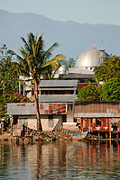 Water village and mosque, Manokwari, West Papua, Indonesia. Manokwari is a small town on the north east coast of the Bird's Head Peninsula, West Papua, Indonesia.  Its harbour has many wrecks from WWII.