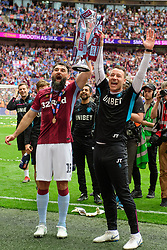 May 27, 2019 - London, England, United Kingdom - Mile Jedinak (15) of Aston Villa and Aston Villa's John Terry celebrate with the trophy during the Sky Bet Championship match between Aston Villa and Derby County at Wembley Stadium, London on Monday 27th May 2019. (Credit: Jon Hobley | MI News) (Credit Image: © Mi News/NurPhoto via ZUMA Press)