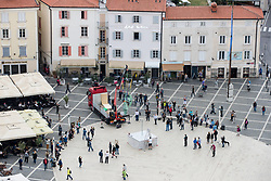 After two months of restoration, the Statue of Archangel Michael, made of copper plate, returned to Piran. The image shows the Statue of Archangel Michael on the truck and spectators before helicopter placing it on top of the church's clock, on October 15, 2018 in Piran, Slovenia. Photo by Matic Klansek Velej / Sportida