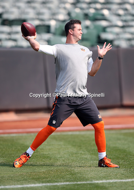 Cincinnati Bengals quarterback AJ McCarron (5) throws a pregame pass while warming up before the 2015 NFL week 1 regular season football game against the Oakland Raiders on Sunday, Sept. 13, 2015 in Oakland, Calif. The Bengals won the game 33-13. (©Paul Anthony Spinelli)
