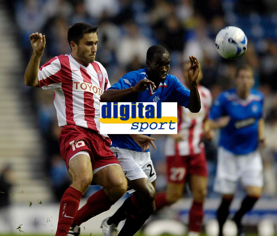 Photo: Jed Wee/Sportsbeat Images.<br /> Glasgow Rangers v Crvena Zvezda. UEFA Champions League Qualifying. 14/08/2007.<br /> <br /> Rangers' Damarcus Beasley (R) keeps his eye on the ball as Red Star's Grezgorz Bronowicki tries to put him under pressure.