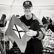 Hermund Kleppa selling flags, t-shirts and other goods to support his campaign of getting the old traditional flags back on the ferry boats of the communty owned company fjord1 or Fylkesbåtane as they are kcalled in Norway