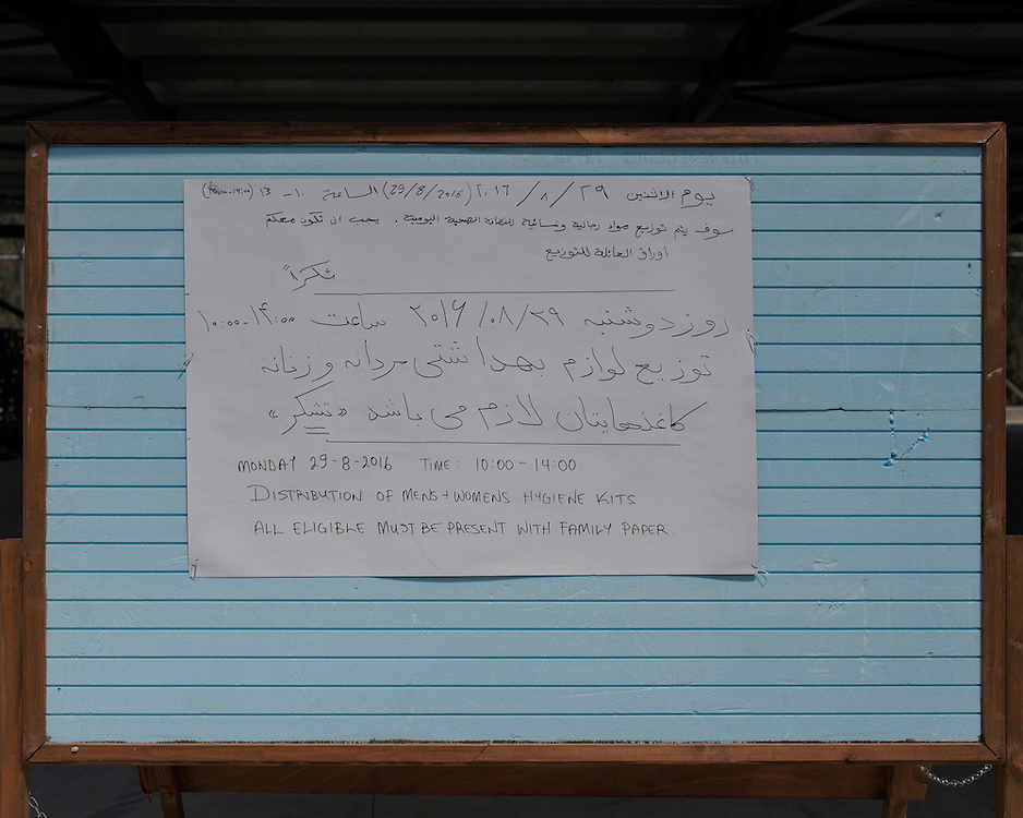 The noticeboard in the  First Reception Centre (Hot-Spot) of Leros, Greece, advertising, in Arabic and English, the distribution of hygiene kits. <br />
