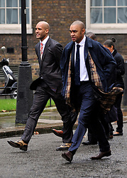 © Licensed to London News Pictures. 22/02/2012, London, UK. (R )Paul Elliott and Clarke Carlisle (L)  The UK Prime Minister holds a summit at Downing Street on racism in football. Photo credit : Stephen Simpson/LNP
