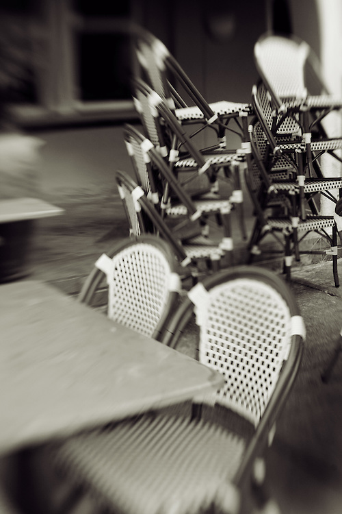 outdoor cafe with piled chairs