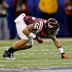January 3, 2012; New Orleans, LA, USA; Virginia Tech Hokies defensive end Tyrel Wilson (66) against the Michigan Wolverines during the Sugar Bowl at the Mercedes-Benz Superdome. Michigan defeated Virginia 23-20 in overtime. Mandatory Credit: Derick E. Hingle-US PRESSWIRE