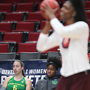 March 31, 2019; Portland, OR, USA;  Oregon Ducks forward Ruthy Hebard (24) watches as Mississippi State Bulldogs center Teaira McCowan (15) takes a shot during warm-us in the Elite Eight of the NCAA Women's Tournament at Moda Center.<br /> Photo by Jaime Valdez