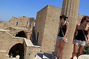 Lindos, beautiful white city on Rhodes Island. Tourists can get to the Akropolis and Athena Lindia sanctaury on donkey back. © Romano P. Riedo