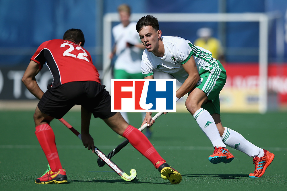 JOHANNESBURG, SOUTH AFRICA - JULY 13: Matthew Nelson of Ireland and Mohamed Zaki of Egypt battle for possession during day 3 of the FIH Hockey World League Semi Finals Pool B match between Ireland and Egypt at Wits University on July 13, 2017 in Johannesburg, South Africa. (Photo by Jan Kruger/Getty Images for FIH)