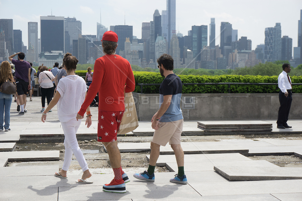 red, white and blue colored clothing on people at the Metropolitan Museum of Art Rooftop art opening