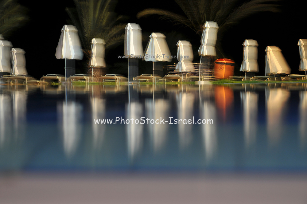 Swimming pool at a resort hotel at night. Paphos, Cyprus