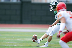 19 September 2015:  Michael Kelley kicks off during an NCAA division 3 football game between the Simpson College Storm and the Illinois Wesleyan Titans in Tucci Stadium on Wilder Field, Bloomington IL
