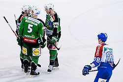 Tomi Mustonen (HDD Tilia Olimpija, #21), Jamie Fraser (HDD Tilia Olimpija, #44) and Scott Hotham (HDD Tilia Olimpija, #5) during ice-hockey match between HDD Tilia Olimpija and KHL Medvescak Zagreb in 22th Round of EBEL league, on November 18, 2011 at Hala Tivoli, Ljubljana, Slovenia. (Photo By Matic Klansek Velej / Sportida)
