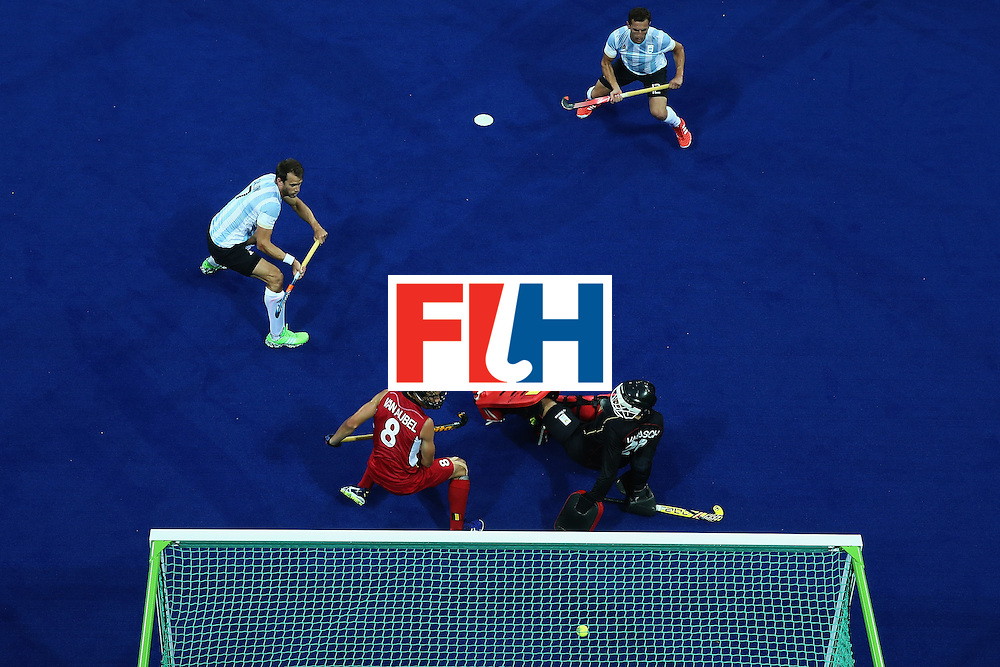 RIO DE JANEIRO, BRAZIL - AUGUST 18:  Facundo Callioni #7 and Gonzalo Peillat #2 of Argentina  watches a shot on goal defended by Florent van Aubel #8 and Vincent Vanasch #21 of Belgium during the Men's Hockey Gold medal match at the Olympic Hockey Centre on Day 13 of the 2016 Rio Olympic Games on August 18, 2016 in Rio de Janeiro, Brazil.  (Photo by Sean M. Haffey/Getty Images)