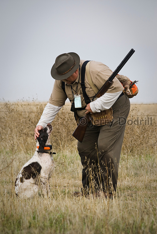 "Jim Dodrill in a moment of affection with his dog ""Lady"" while pheasant hunting at Quail Point Hunting Preserve, Zamora, California"