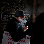 KILLARNEY, IRELAND - FEBRUARY 28, 2015: An elder protestor listening to anti-austerity speeches at a anti-water chargers protest in Killarney, southern Ireland. More than 500 protesters from around the country marched from the town centre in Killarney to the INEC convention centre where the Labour Party's annual conference was being held. The protesters peacefully demonstrated against water charges, as well as for the release of five of their fellow protestors who were jailed for contempt of court earlier in the month. CREDIT: Paulo Nunes dos Santos for The New York Times