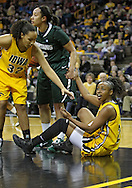January 27 2010: Iowa guard Kachine Alexander (21) argues a foul as she is helped up by Iowa forward Jade Rogers (32) and Michigan St. forward Kalisha Keane (32) during the first half of an NCAA women's college basketball game at Carver-Hawkeye Arena in Iowa City, Iowa on January 27, 2010. Iowa defeated Michigan State 66-64.