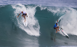 December 11, 2017 - Banzai Pipeline, HI, USA - BANZAI PIPELINE, HI - DECEMBER 11, 2017 - Kelly Slater of the United States drops in as Joan Duru of France falls in the first round of the Billabong Pipe Masters. Slater was not called for interference. (Credit Image: © Erich Schlegel via ZUMA Wire)