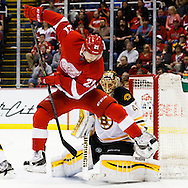 Apr 2, 2015; Detroit, MI, USA; Detroit Red Wings left wing Tomas Tatar (21) leaps over a shot puck in front of Boston Bruins goalie Tuukka Rask (40) in the third period at Joe Louis Arena. Boston won 3-2. Mandatory Credit: Rick Osentoski-USA TODAY Sports
