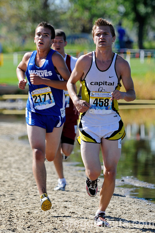 Timberline senior James Gutierrez and Capital sophomore Blake Wilcox on the beach section during the Bob Firman Invitational elite boy's race at Eagle Island State Park on September 25, 2010.