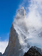 Cerro Poincenot rises to 3002m (or 9849 ft) in Los Glaciares National Park, in the southern Andes mountains, Argentina, South America. The foot of South America is known as Patagonia, a name derived from coastal giants, Patagão or Patagoni, who were reported by Magellan's 1520s voyage circumnavigating the world and were actually Tehuelches native people who averaged 25 cm (or 10 inches) taller than the Spaniards.