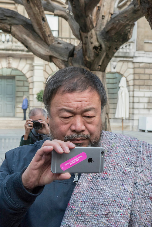 Ai Weiwei films the photogrpahers (in front of his Trees) before  leaving the Royal Academy in a media scrummage - Anish Kapoor and Ai Weiwei go for a walk in London - The two artists have joined hands to walk out of London on Thursday. Each will carry a single blanket as a symbol of the need that faces 60 million refugees in the world today. The Artists have said that they welcome Londoners to join them along their route and ask that Londoners too bring a blanket in gesture of support. The artists will repeat this action in cities across the world over the next few months. The walk started at 10am on Thursday 17th September, at the Royal Academy of Arts passed: Piccadilly Circus; Trafalgar Square; Whitehall;  St Paul's Cathedral; Bank and ended up at Stratford.