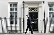 © Licensed to London News Pictures. 21/03/2012. Westminster, UK. The Health Secretary Andrew Lansley walks past number 11 Downing Street on the day of the budget on March 21, 2012. The Chancellor is expected to raise the amount of money people can earn before income tax takes hold and impose a new levy on the purchase of expensive homes. Photo credit : Stephen SImpson/LNP