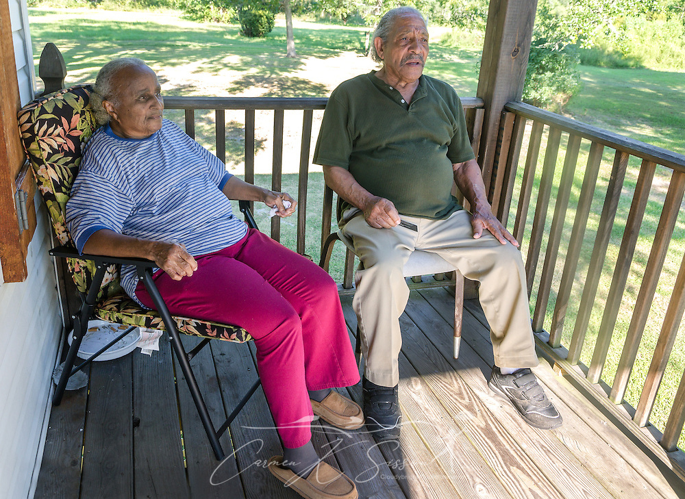 Mary and Thomas Robinson sit on their porch, Aug. 28, 2015, in Pass Christian, Mississippi. Mrs. Robinson's brother, Arthur Meunier III, drowned during Hurricane Katrina in 2005. The Robinsons home was destroyed, but they have since rebuilt. (Photo by Carmen K. Sisson/Cloudybright)