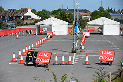 © Licensed to London News Pictures. 26/04/2020. WATFORD, UK. A general view of a testing centre which opened in the car park of Watford General Hospital on 23 April (shown as two white tents).  Those eligible to use the test centre are hospital staff members or their household who are symptomatic of Covid 19.  To accelerate the testing programme towards a target of 100,000 tests per day by 30 April set by Matt Hancock, Health Secretary, many more testing centre have been set up in the last few days including mobile pop-up test centres. Photo credit: Stephen Chung/LNP