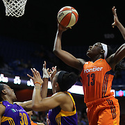 UNCASVILLE, CONNECTICUT- MAY 26:  Chiney Ogwumike #13 of the Connecticut Sun rebounds above her sister Nneka Ogwumike #30, (left), of the Los Angeles Sparks and Candace Parker #3 of the Los Angeles Sparks during the Los Angeles Sparks Vs Connecticut Sun, WNBA regular season game at Mohegan Sun Arena on May 26, 2016 in Uncasville, Connecticut. (Photo by Tim Clayton/Corbis via Getty Images)