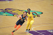 Connecticut Sun guard Jasmine Thomas (5) charges up court with Los Angeles Sparks guard Alexis Jones (1) defending during a WNBA basketball game, Friday, May 31, 2019, in Los Angeles.The Sparks defeated the Sun 77-70.  (Dylan Stewart/Image of Sport)