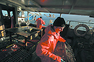Fishermen Davie Smith (foreground) and John Macgregor, working aboard their vessel My Amber, as they fish for prawns off Scotland's west coast in a marine 'box' in the inner sound of Rona which restricts entry to large trawlers looking for white fish and allows around 16 creelers unrestricted fishing.