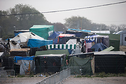 © Licensed to London News Pictures . 24/10/2016 . Calais , France . The Jungle migrant camp in Calais , Northern France on the day of a planned eviction and start of the destruction of the camp . Photo credit: Joel Goodman/LNP