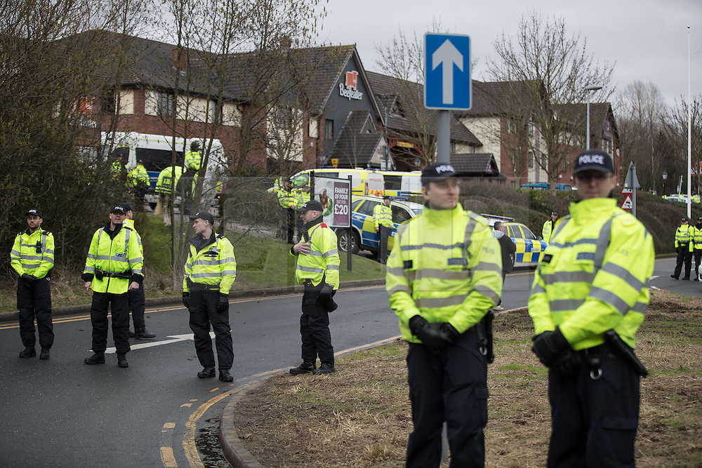 © Licensed to London News Pictures. 25/02/2017. Telford, UK. Hundreds of police , including mounted units and vehicles , manage a Britain First demonstration and march in Telford , which is opposed by anti-fascist groups . Britain First say they are highlighting concerns about child sexual exploitation in the town . Photo credit: Joel Goodman/LNP
