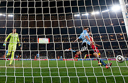 Goalkeeper of Uruguay Fernando Muslera and Maximiliano Pereira of Uruguay saving a goal during overtime at the 2010 FIFA World Cup South Africa Quarter Finals football match between Uruguay and Ghana on July 02, 2010 at Soccer City Stadium in Sowetto, suburb of Johannesburg. (Photo by Vid Ponikvar / Sportida)