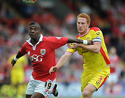 Bristol City's Kieran Agard and Milton Keynes Dons' Dean Lewington jostle for the ball  - Photo mandatory by-line: Dougie Allward/JMP - Mobile: 07966 386802 - 27/09/2014 - SPORT - Football - Bristol - Ashton Gate - Bristol City v MK Dons - Sky Bet League One