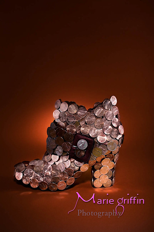 Illustration shoe product covered in pennies for the idea of being stylish on the cheap.<br />